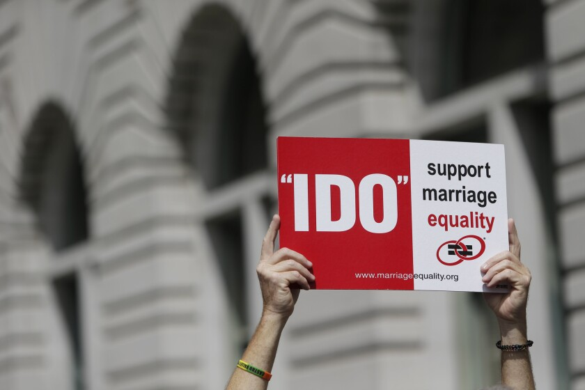 A supporter of gay marriage holds a sign outside the U.S. 9th District Court of Appeals in San Francisco.