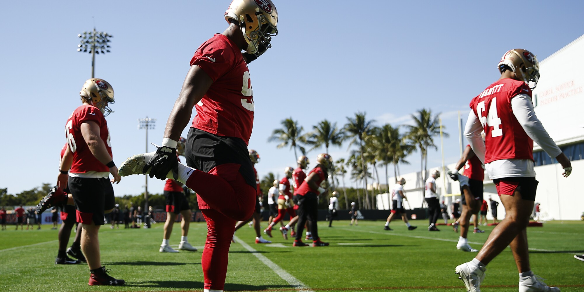 The San Francisco 49ers stretch during practice at the University of Miami on Thursday.