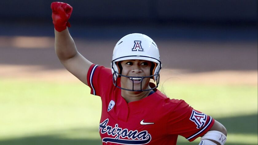Arizona's Dejah Mulipola looks to the bench after hitting a solo home run to lead off the second inn