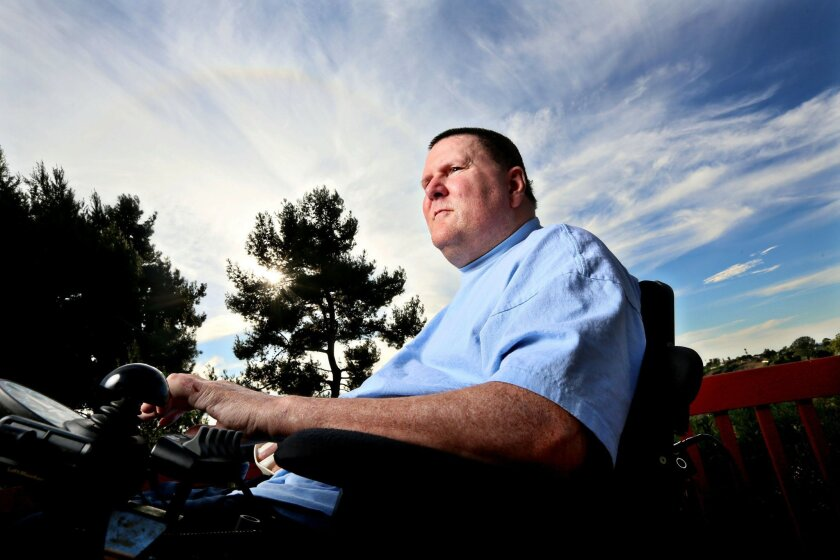 Dan Walters, a former police officer who was paralyzed in 2003 after being shot in the neck, sits in his wheelchair on his back porch at home in San Diego in 2013.