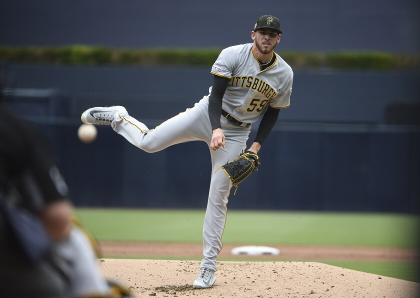 Pirates starter Joe Musgrove, a Grossmont High alum, pitches against the Padres on Sunday at Petco Park.