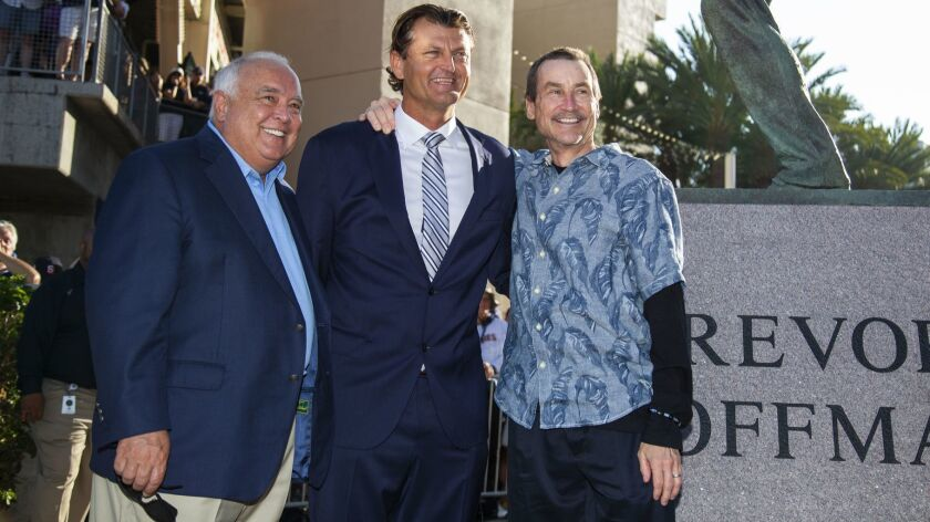 The Padres honored Hall of Fame closer Trevor Hoffman by unveiling a statue of him in left field near the bullpen at Petco Park on Saturday, Aug. 18, 2018. Hoffman poses with Padres executive chairman Ron Fowler and managing partner Peter Seidler.