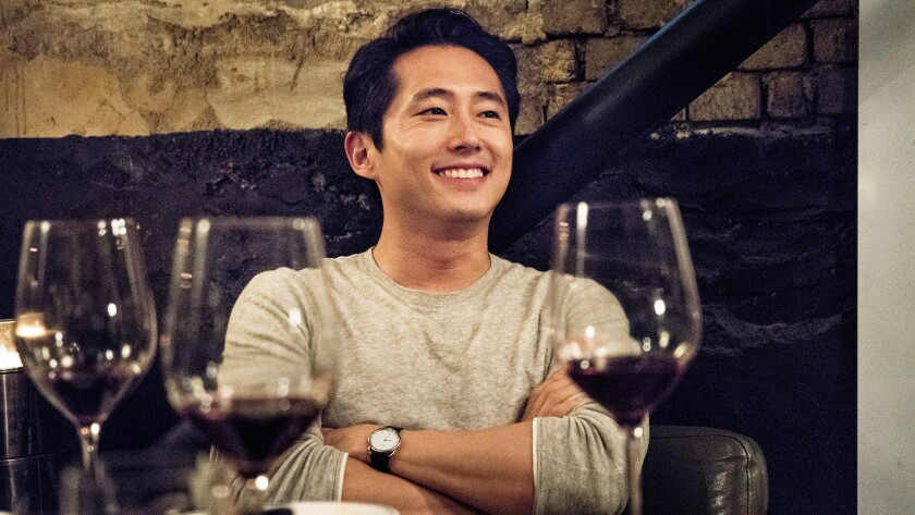 "This image released by Well Go USA Entertainment shows Steven Yeun in a scene from ""Burning."""