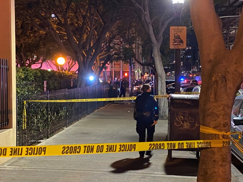 SDPD investigates at scene Thursday night in downtown where at least one officer shot a man allegedly armed with a knife.