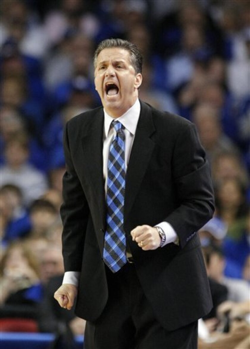 Kentucky coach John Calipari yells instructions to his team during the first half of an  NCAA college basketball game against North Carolina-Asheville in Louisville, Ky., Monday, Nov. 30, 2009.  (AP Photo/Ed Reinke)