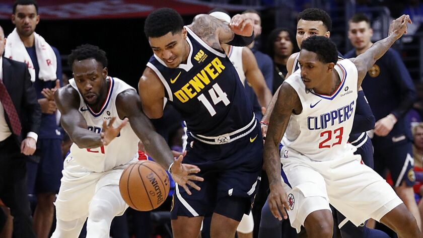 LOS ANGELES, CALIF. - OCT. 17, 2018. Clippers Patrick Beverley, left, and Lou Willimas lose control
