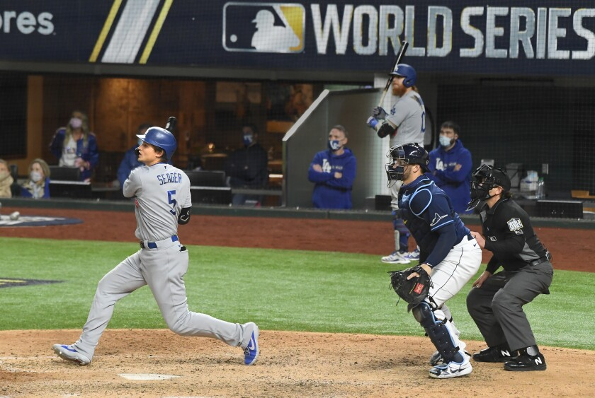 The Dodgers' Corey Seager hits a go-ahead single with two outs in the eighth inning in Game 4 of the World Series.