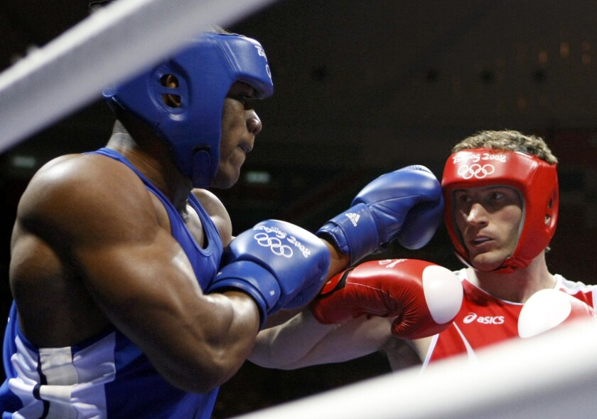 Cammarelle of Italy fights Rivas of Colombia during the men's super heavyweight (+91kg) quarterfinal 3 boxing match at the Beijing 2008 Olympic Games