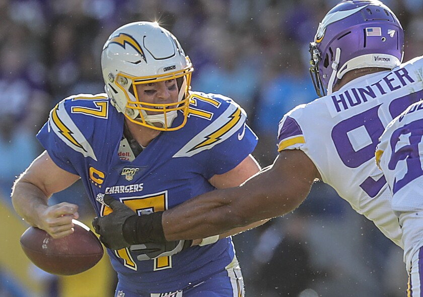 Minnesota Vikings defensive end Danielle Hunter (99) strips the ball from Chargers quarterback Philip Rivers.