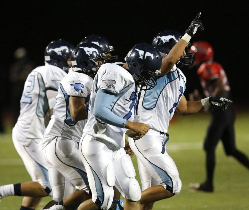 Otay Ranch's defense celebrates creating another turnover at the football game between Mt. Miguel High School at Otay Ranch High School Friday night at Mt. Miguel High.