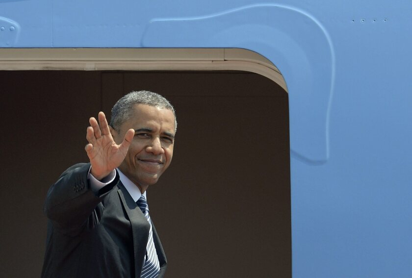 President Obama boards Air Force One in Tokyo for a flight to South Korea, where he was to preside over a naturalization ceremony at a U.S. military base.