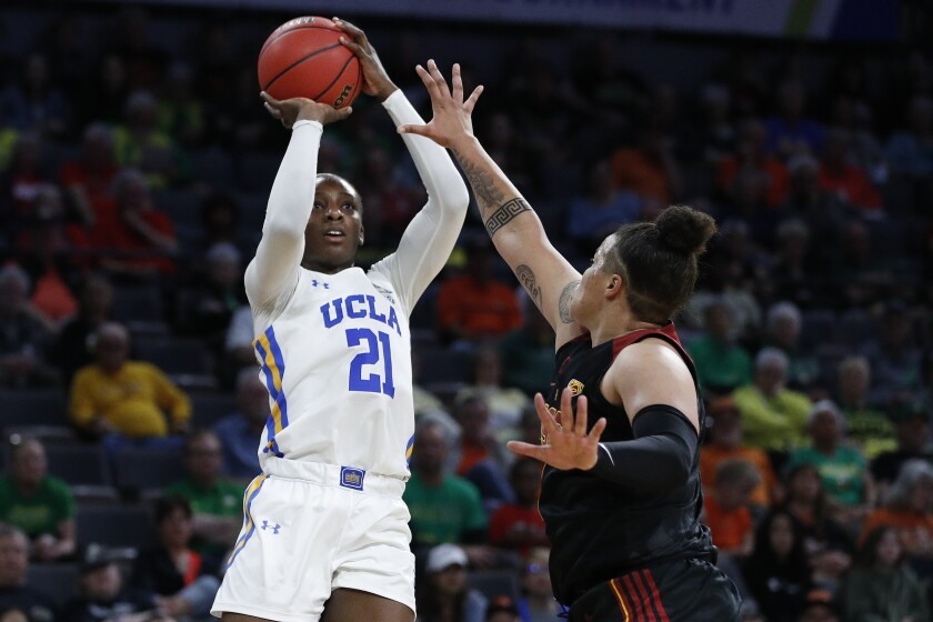 UCLA's Michaela Onyenwere shoots over USC's Kayla Overbeck during a Pac-12 women's tournament quarterfinal game March 6, 2020, in Las Vegas.