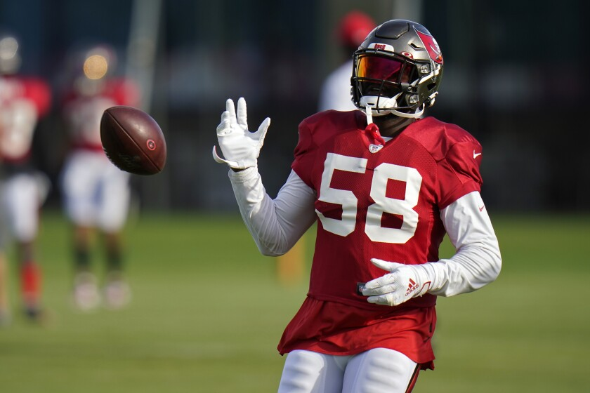 FILE - In this Aug. 18, 2020, file photo, Tampa Bay Buccaneers linebacker Shaquil Barrett (58) knocks the ball away during NFL football training camp in Tampa, Fla. The Bucs face the Broncos on Sunday, Sept. 27, 2020, in Denver. (AP Photo/Chris O'Meara, File)