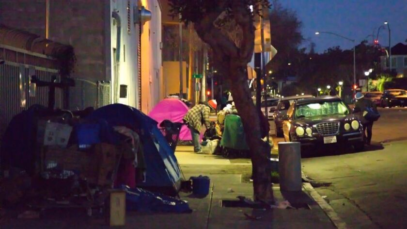 Homeless pitch tents in downtown San Diego.