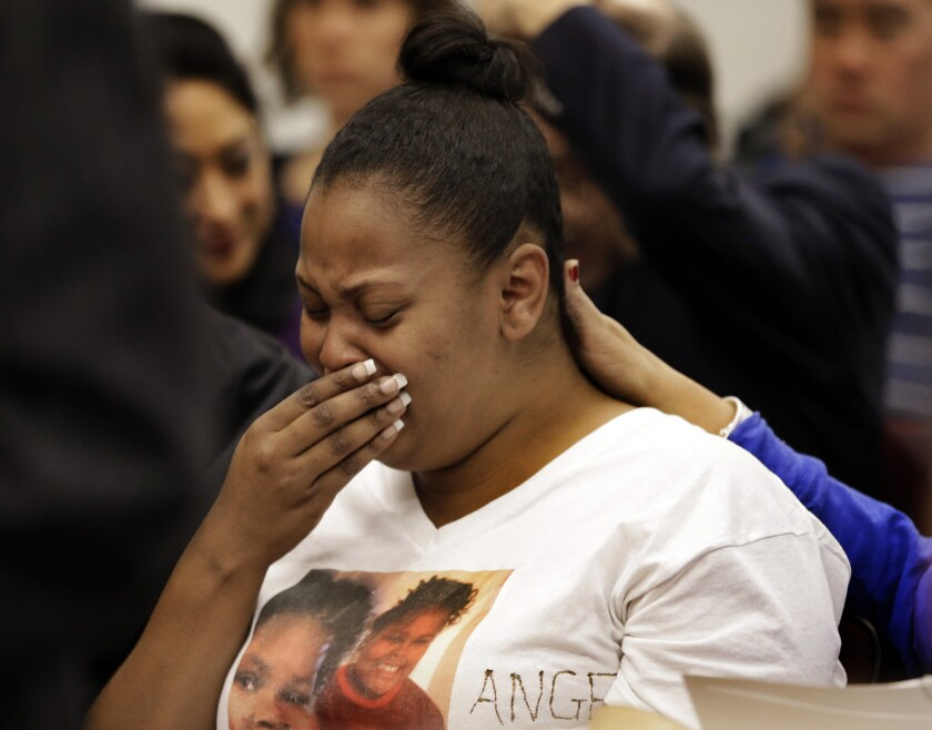 Nailah Winkfield, mother of 13-year-old Jahi McMath, cries before a courtroom hearing regarding McMath, on Dec. 20, 2013, in Oakland.