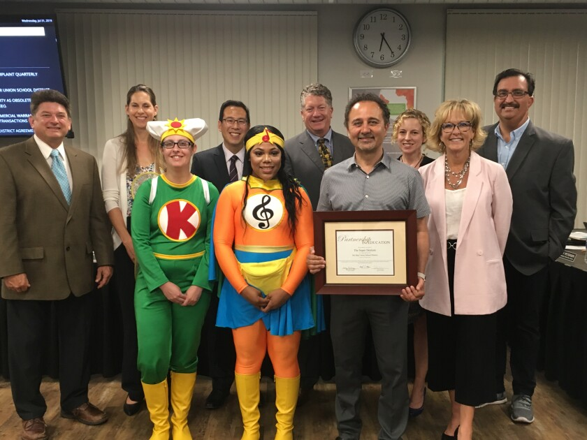 Del Mar Union School District has teamed up with The Super Dentists on a new corporate partnership. Dr. Kami Hoss is seen here with The Tooth Keri and Melo-D and DMUSD board members Scott Wooden, Katherine Fitzpatrick, Gee Wah Mok, Doug Rafner, Erica Halpern, Assistant Superintendent Jason Romero and Superintendent Holly McClurg.