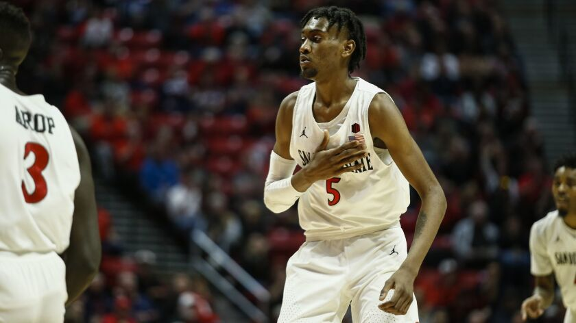 SDSU forward Jalen McDaniels reacts after making a basket in the first half against Boise State.