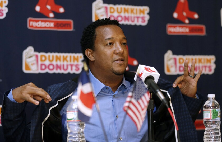 Former Boston Red Sox pitcher Pedro Martinez speaks at a new conference Tuesday after being elected to the Baseball Hall of Fame.