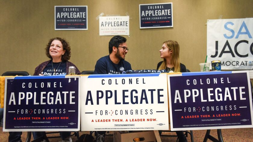Campaign staff run a table for Democrat Doug Applegate before a debate featuring Democratic candidat