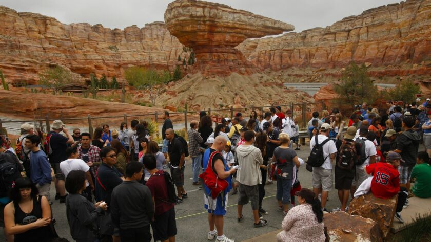 Vistors wait for the new Radiator Springs Racers in Cars Land to open at Disney California Adventure Park on opening day, June 15, 2012.
