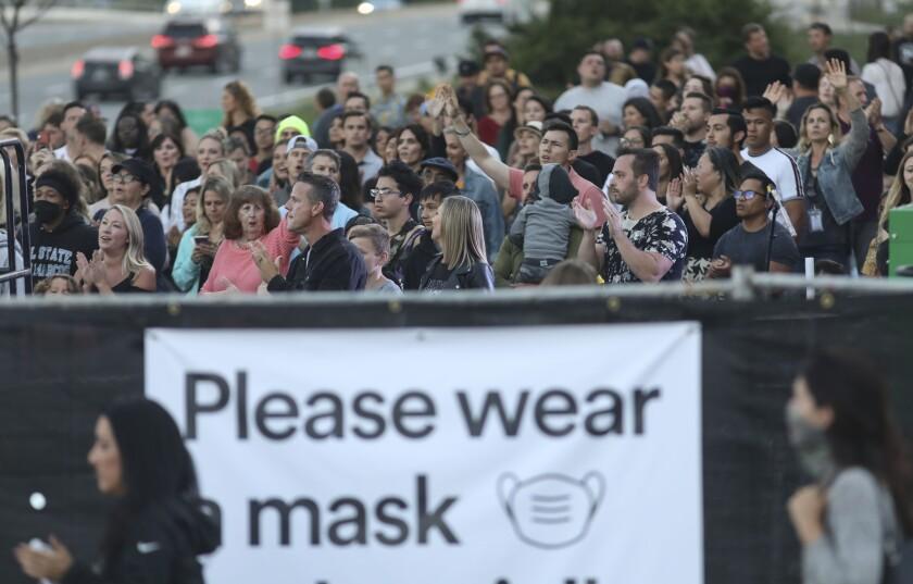 Congregants attend an Awaken Church mass in the parking lot at their church in Kearny Mesa