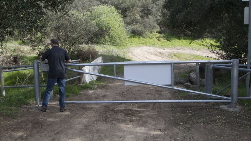 Eric Armstrong, the engineer for the Newland Sierra project, closed a security gate on the property. The 1,800 acres of the proposed Newland Sierra development project is in the Twin Oaks area north of Escondido.