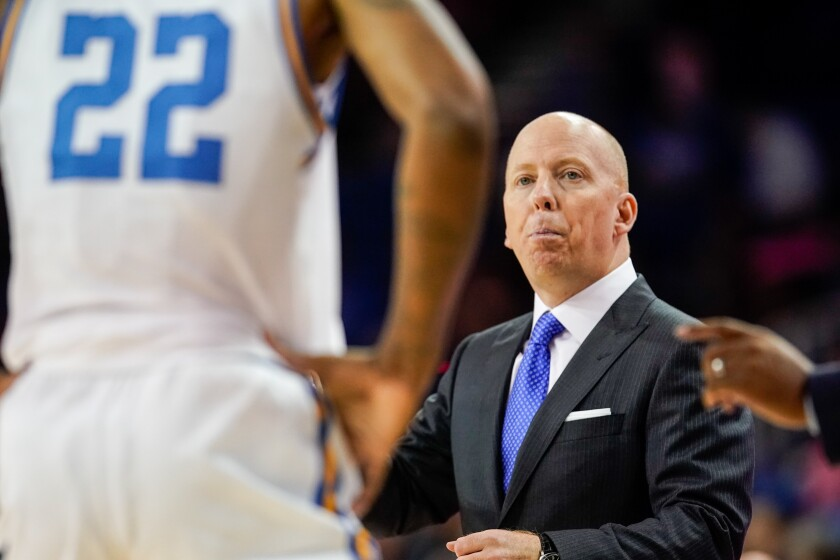 UCLA head coach Mick Cronin looks at forward Shareef O'Neal (22) during the first half of a game against Long Beach State on Nov. 6 at Pauley Pavilion.