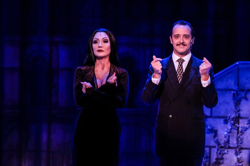 """Erica Marie Weisz as Morticia and Kevin Hafso-Koppman as Gomez in """"The Addams Family: A New Musical Comedy"""" at Welk Resort Theatre."""