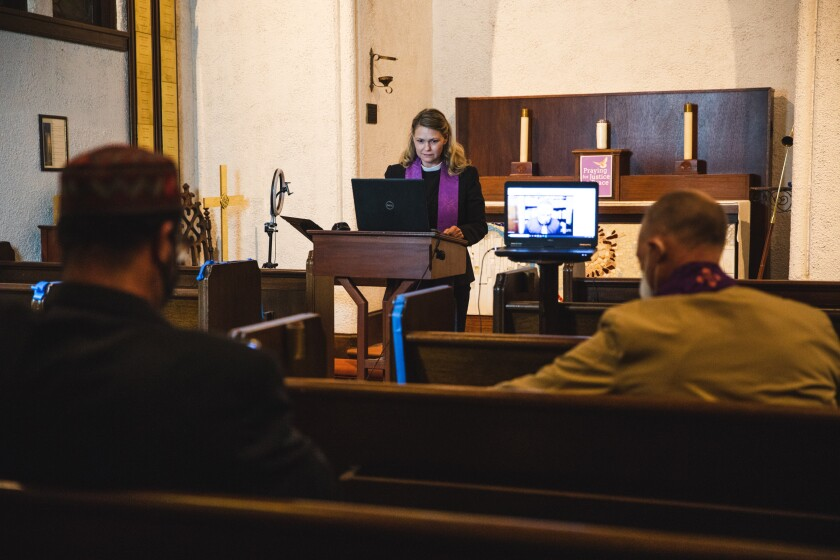 Rev. Rebecca Dinovo prays at virtual vigil at St. James by-the-Sea Episcopal Church in La Jolla on Tuesday.
