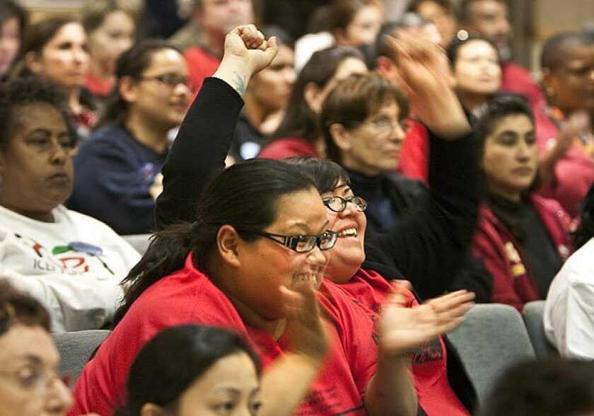 Audience members react as the L.A. Unified Board of Education decides how to divvy up 30 campuses Tuesday. The board decided not to turn over schools to three leading charter school operators.