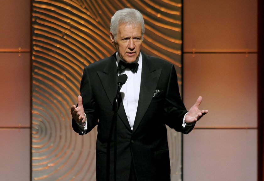 """FILE - In this June 16, 2013 file photo, """"Jeopardy!"""" game show host Alex Trebek appears at the 40th Annual Daytime Emmy Awards in Beverly Hills, Calif. The show said Canadians were precluded from taking last month's online test that is a pipeline for the show's contestants because of a change in th"""