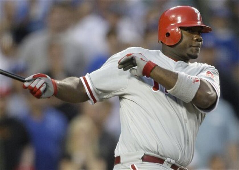 In this Oct. 15, 2008 file photo, Philadelphia Phillies Ryan Howard bats against the Los Angeles Dodgers in Game 5 of the National League championship baseball series in Los Angeles.   Howard has asked for $18 million in salary arbitration, the third-highest figure submitted since the process bega