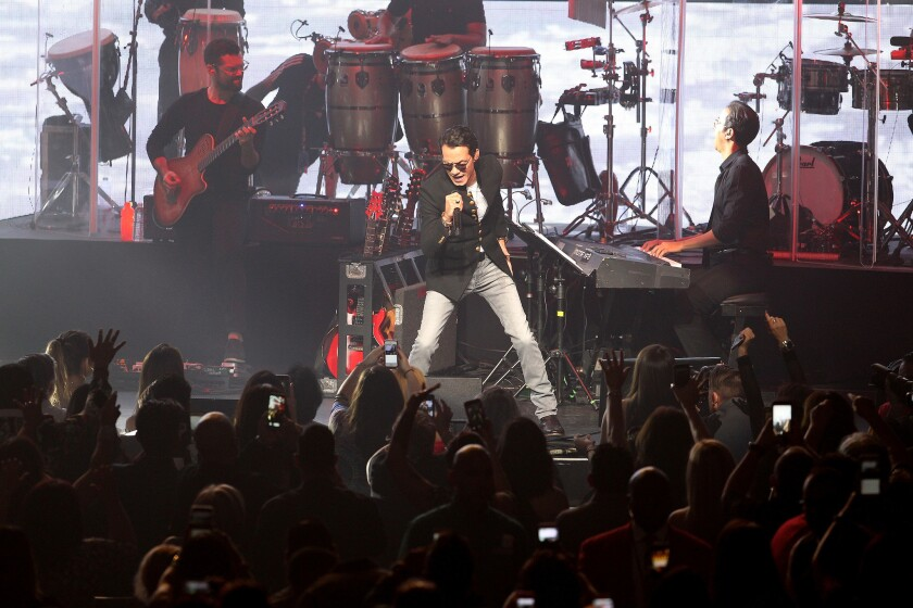 Marc Anthony performs onstage during the Marc Anthony Live Tour at the Microsoft Theater on October 07, 2016 in Los Angeles, CA. (Photo by © Art. Garcia/DDPixels.com)