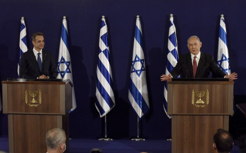 Israeli Prime Minister Benjamin Netanyahu, right, and Greek Prime Minister Kyriakos Mitsotakis give joint statements in Jerusalem, Tuesday, June 16, 2020. (Debbie Hill, UPI Pool via AP)
