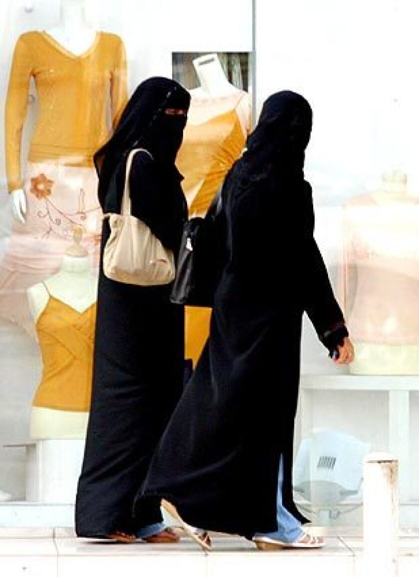 CULTURAL DIVIDE: The author found that the act of wearing the abaya, as these Saudi women in the capital do, inculcated in her a profound sense of self-consciousness.