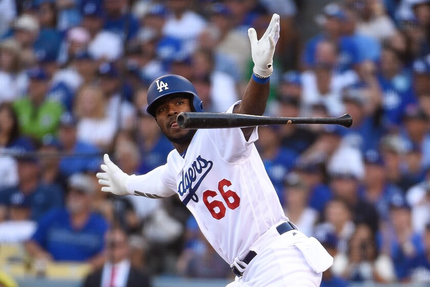 Yasiel Puig #66 of the Los Angeles Dodgers reacts after hitting a RBI single in the sixth inning against the Milwaukee Brewers in Game Five of the National League Championship Series at Dodger Stadium on October 17, 2018 in Los Angeles, California.