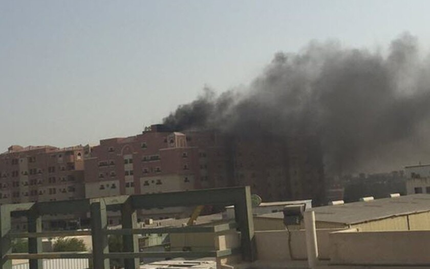 Thick black smoke billows from a fire at a multistory residential compound known as Radium that accommodates workers for state oil giant Saudi Aramco, in the eastern city of Khobar, Saudi Arabia, Sunday, Aug. 30, 2015.