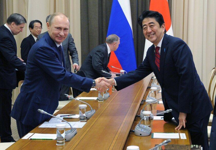 Russia, Japan seek to resolve dispute over islands, WW II treaty