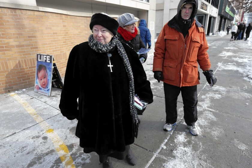 Antiabortion protester Eleanor McCullen, left, was the lead plaintiff in the lawsuit that led the Supreme Court to abolish a 35-foot buffer zone in Massachusetts to keep protesters away from clients at abortion clinics.