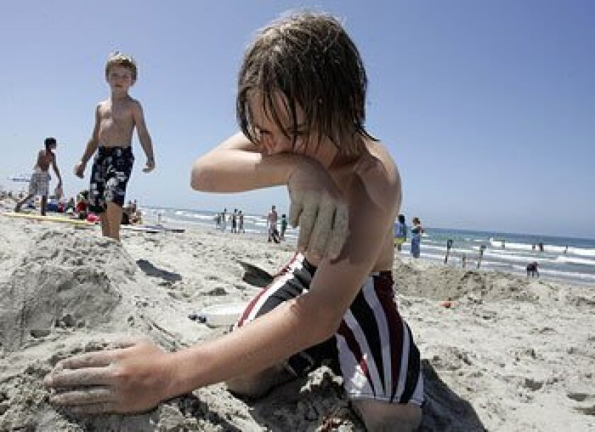 Aaron Shea, 11, of Temecula played in the sand this week near the Oceanside pier. (John Gastaldo / Union-Tribune)