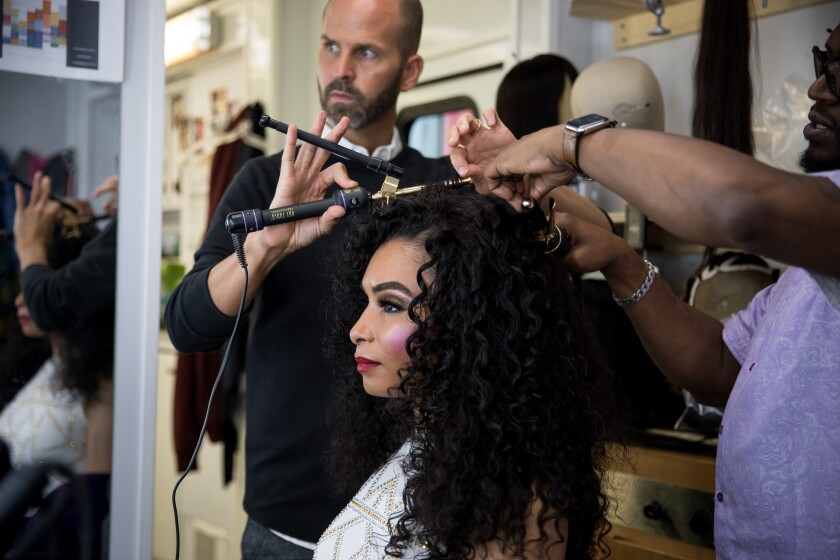 "The hair department readies a performer for the spotlight on the set of ""Pose."""