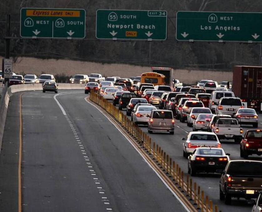 Some of Orange County's toll roads have struggled to attract drivers, and each of the major corridors has been forced to refinance its debt to avoid possible default. Above, the Express Lanes on the westbound 91 Freeway.