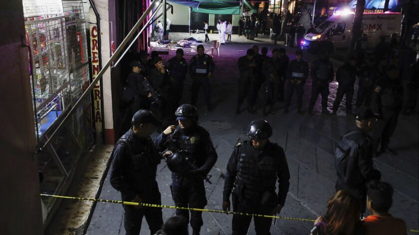 Police block access to a crime scene after a shooting in Plaza Garibaldi in Mexico City, Friday, Sep