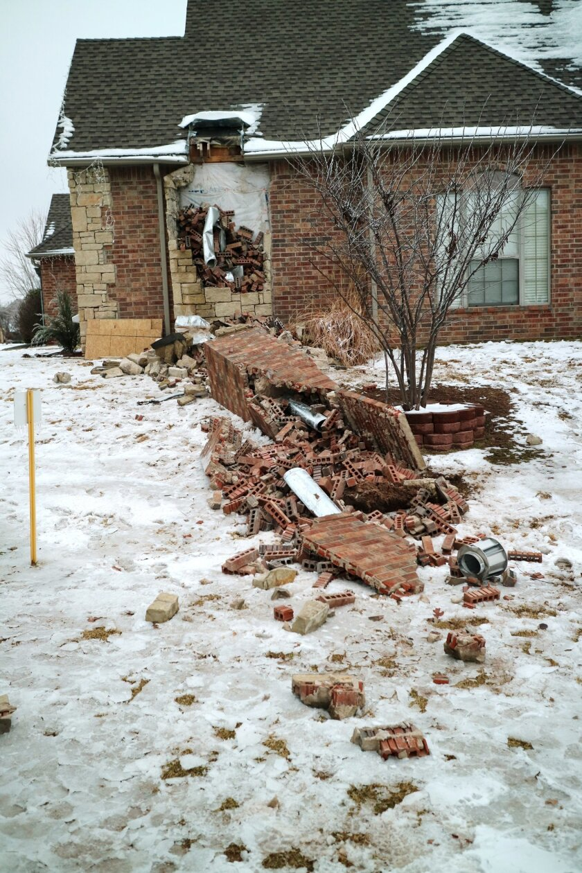 In this Dec. 29, 2015 photo, remains of a collapsed chimney rest on the ground outside a home in Edmond, Okla., following an earthquake. In Oklahoma the stronger and more frequent earthquakes have people worrying about the big one. In Oklahoma, now the country's earthquake capital, people are talking nervously about the big one as man-made quakes get stronger, more frequent and closer to major population centers. (Doug Hoke/The Oklahoman via AP) LOCAL STATIONS OUT (KFOR, KOCO, KWTV, KOKH, KAUT OUT); LOCAL WEBSITES OUT; LOCAL PRINT OUT (EDMOND SUN OUT, OKLAHOMA GAZETTE OUT) TABLOIDS OUT; MANDATORY CREDIT