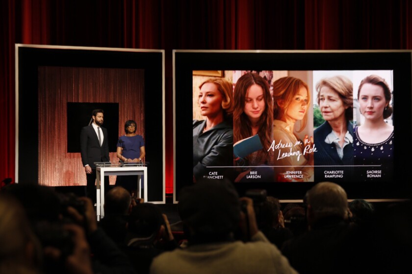 Actor John Krasinski, left, and Academy President Cheryl Boone Isaacs announce nominees for the lead actress category.