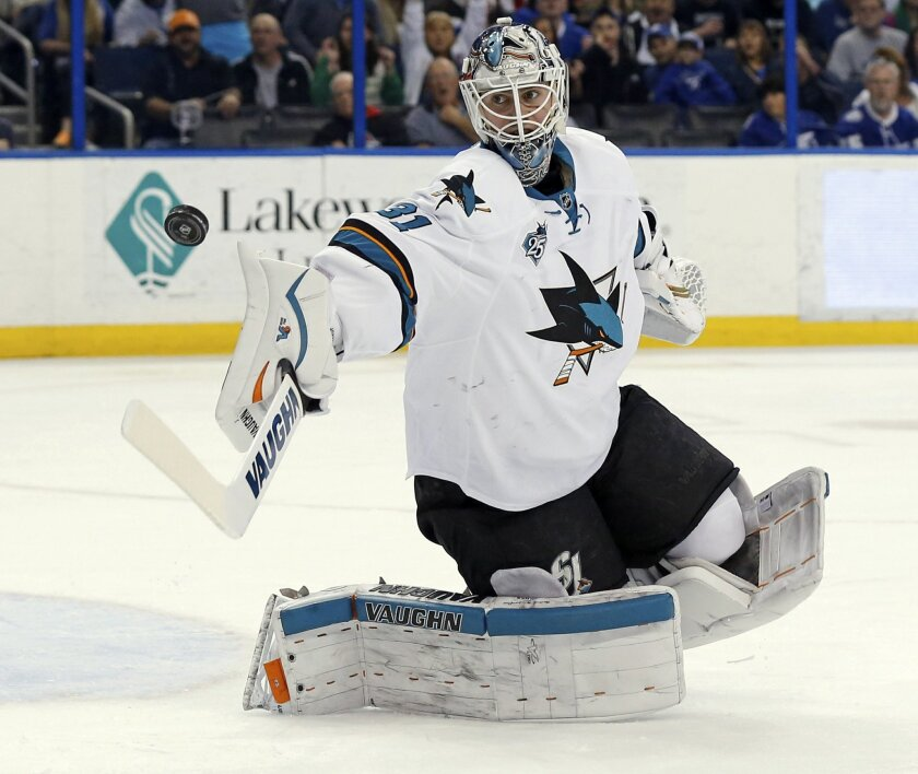 San Jose Sharks goalie Martin Jones makes a save against the Tampa Bay Lightning during the second period of an NHL hockey game Tuesday, Feb. 16, 2016, in Tampa, Fla. (AP Photo/Mike Carlson)