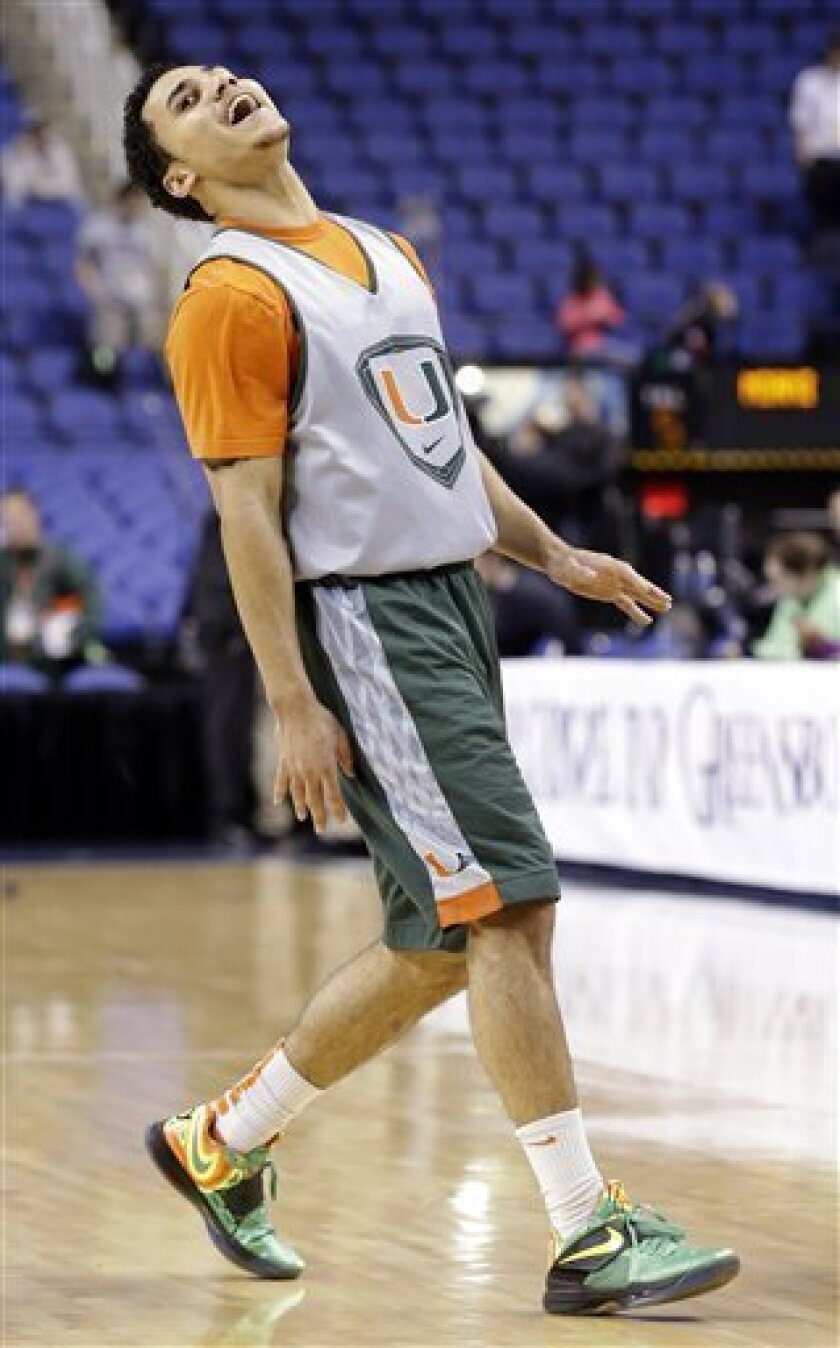 Miami's Shane Larkin reacts following a shot during practice for an NCAA college basketball game at the Atlantic Coast Conference tournament in Greensboro, N.C., Wednesday, March 13, 2013. (AP Photo/Gerry Broome)