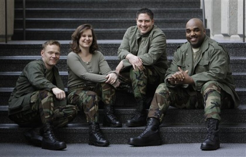 FILE - In this March 23, 2010 file photo, the group 4Troops, from left, Daniel Jens, Meredith Melcher, Ron Henry, and David Clemo are shown in Nashville, Tenn. (AP Photo/Mark Humphrey, file)