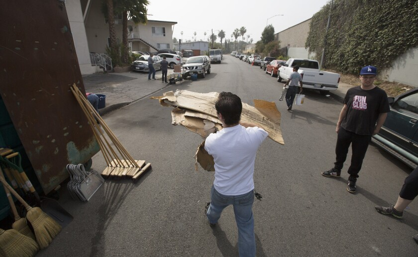 A team of volunteers clean up Kingsley Street in a monthly meet-up organized by the East Hollywood Neighborhood Council.
