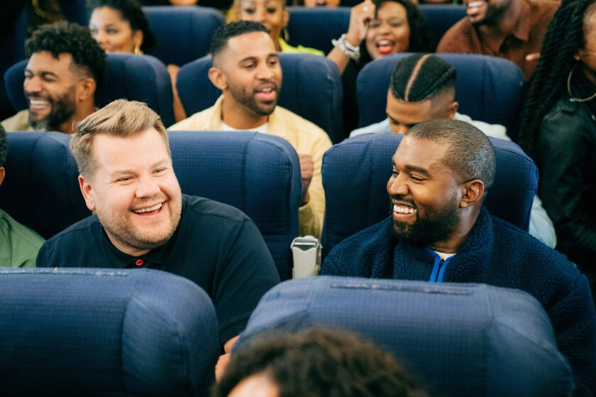 """""""Late Late Show"""" host James Corden, left, joins rapper Kanye West for """"Airpool Karaoke"""" with West's Sunday Service choir."""